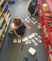 """Jaelyn and her buddy were very into the math game from their """"Penguin"""" backpack"""