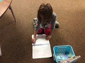 Grace doing word work.
