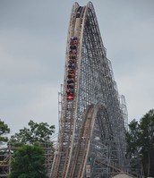Roller coaster cart going down the Hades 360 hill.
