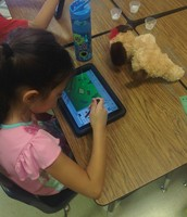 1st Graders are creating their own story on the app Pixie!