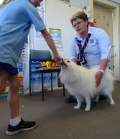 Vicki showing Persia how to hold her hand safely when greeting a dog.