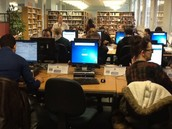 Alison helping students study in the Library
