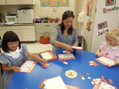 Parent Helpers play games with Kindergartners in Mrs. Hale's Class!