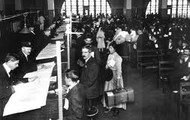 Immigrants arriving to Ellis Island in New York