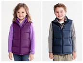 The kids are all smiles with their cute vests.