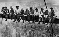 Immigrants working on skyscrapers.