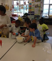 Taking turns mixing the ingredients!