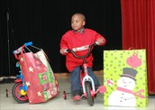 A grateful, young recipient of a new bike in time for Christmas
