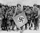 Group Of Easy Company Soldiers Holding Up Nazi Flag