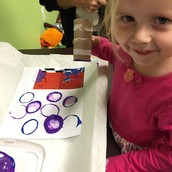 Madelyn made grape and blueberry prints .
