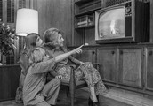1960s family watching the news