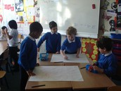 Creative minds coming together to design a group recycled art project