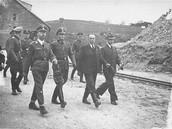 Heinrich himmmler walks with nazi soldiers.