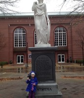 FLat Stanley and Elise in Front of the Athena Statue in Downtown Athens