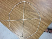 Tie string across the diameter in two directions. Tie tightly.