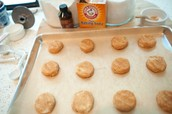 Place the individual cookies onto the cookie sheet. Then put in the oven to bake.
