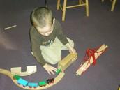 Fine Motor-putting together train tracks