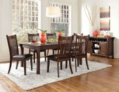 Complete The House With a Coaster Dining Set