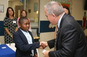 Students Greet State School Superintendent