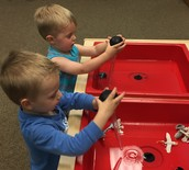 The boys at water table in Sensory Room.