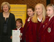 Theresa May hands out certificate