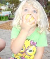 Kate enjoying her juicy apple.