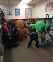 Students enjoying costumes and blow-up characters
