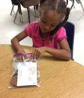 1st Grade preparing snack bags