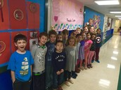 Standing with our banner for Mrs. Crain! 100 miles wow!