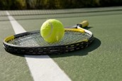 Tennis Racket and Tennis Ball on the Courts