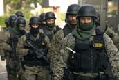 Police Sporting Heavy Body Armor