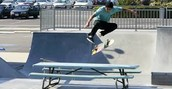 Kick flip over the picnic table.