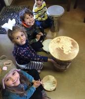 Mila, Gia, Gavin, and John on the drum line!
