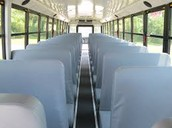 the inside of a school bus,no seatbelts you see which can probably lead to a fatal accident if kid falls out of there seat
