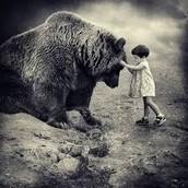 A Little Girl Petting an Adult Bear