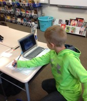 Elijah researching on a Chromebook