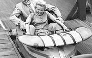 A couple on an amusement park ride.