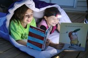 Reading by flashlight!