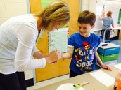Making leprechaun hand prints with Mrs. Tungate