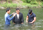 Pastor Uy being baptized.