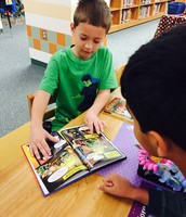 Sharing our awesome books with friends in the library!