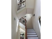 Soaring high ceilings and spiral staircase