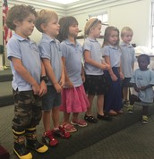 Our youngest class (K4) reciting their history and science in chapel