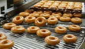 Doughnuts being made