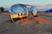 a couple reflect in the sunglasses
