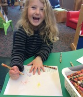 Lexi draws a happy picture