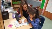 Reading Teacher Megan Metz helping out in Kindergarten