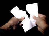 Tearing paper in half