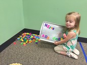 Then, Ada chose to work with magnet letters