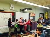 Fourth grade sharing their work